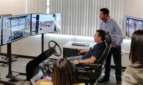 Fontana Unified administrators learn to operate a forklift simulator at Citrus High School, which offers a construction pathw